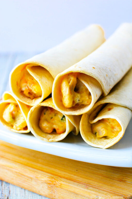 stack of taquitos on a plate