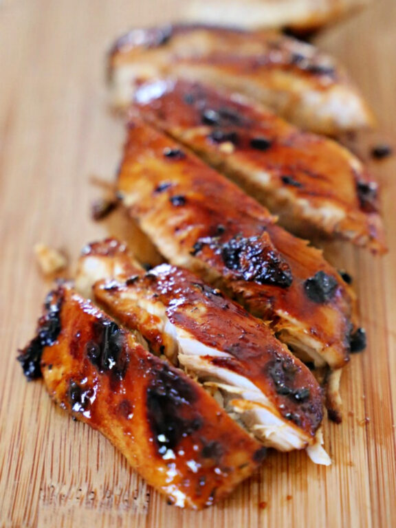 grilled Caribbean chicken on a cutting board