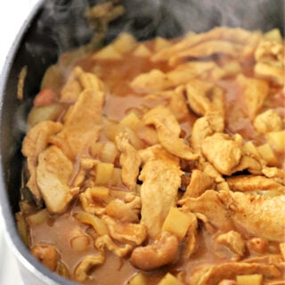 massaman curry cooking in a skillet