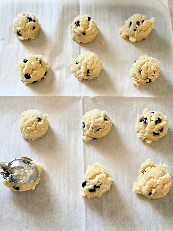 placing scoops of cookie dough on a baking sheet