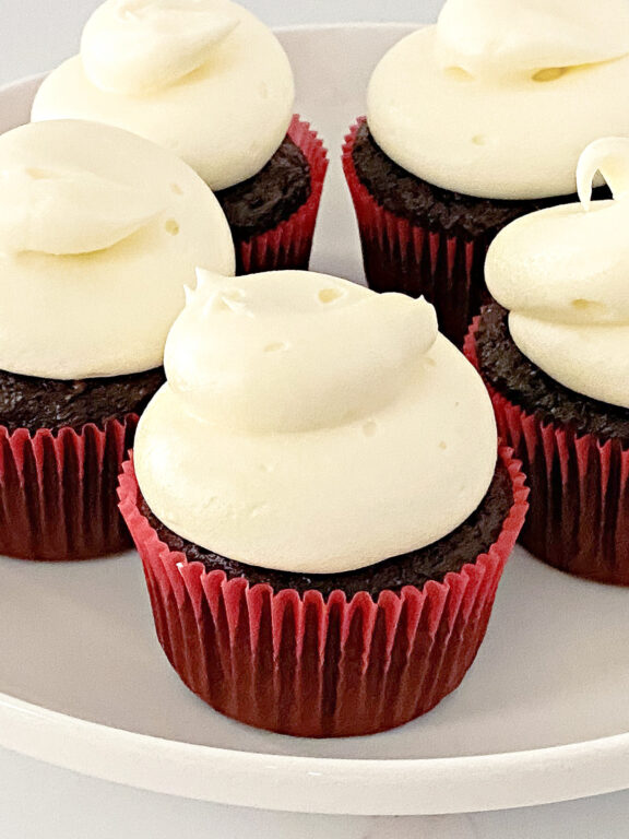 cupcakes with cream cheese frosting on a plate