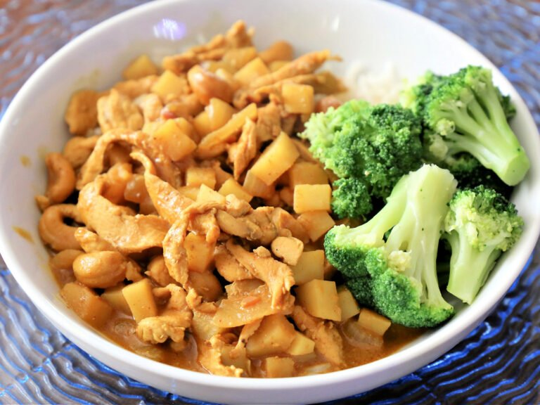 bowl of massaman curry and broccoli