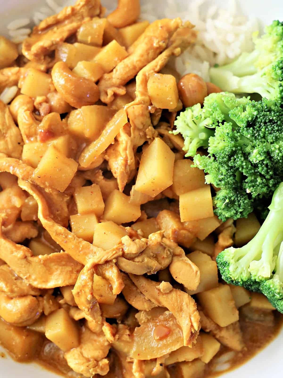 Massaman curry and broccoli in a bowl