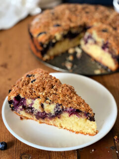 slice of blueberry coffee cake on a plate