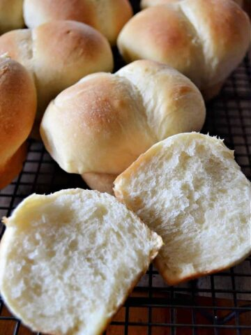 dinner rolls on a wire rack