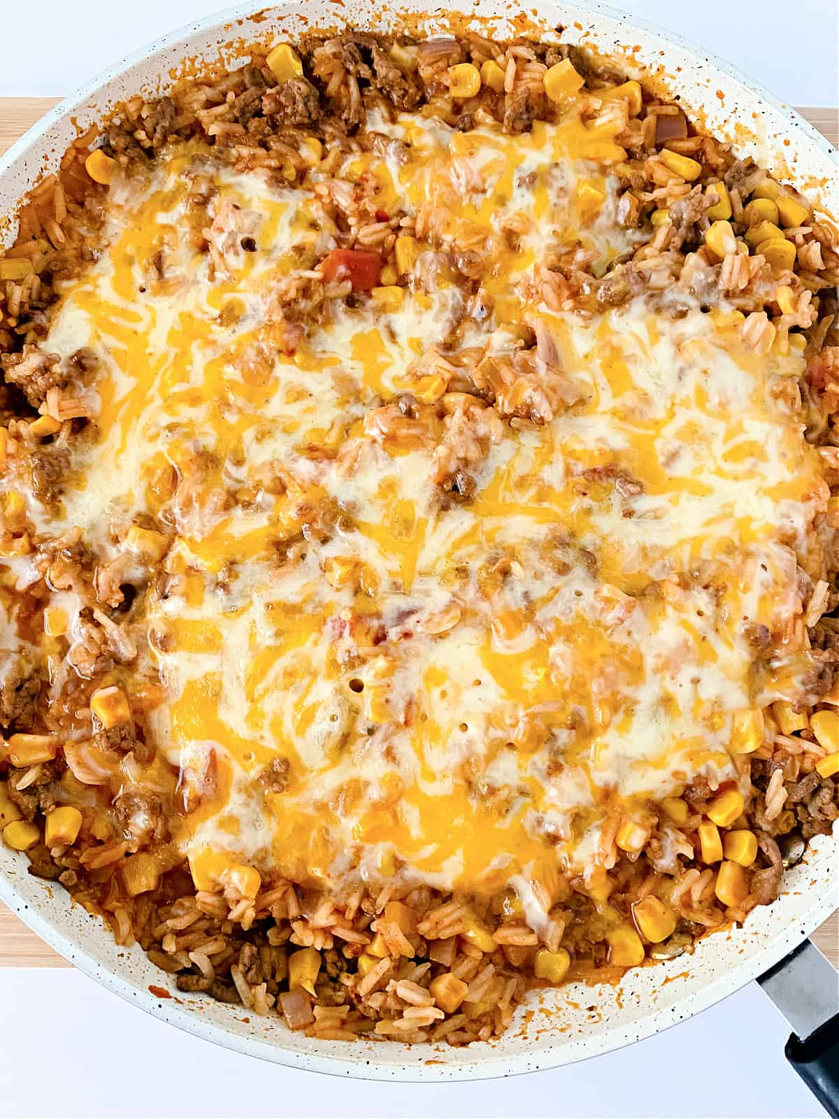 Close up view of Mexican Casserole with Rice topped with cheese.