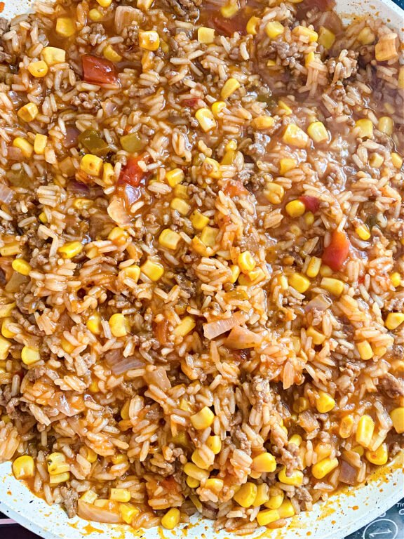 rice, corn, and ground beef in skillet