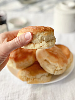 woman holding a Southern biscuit