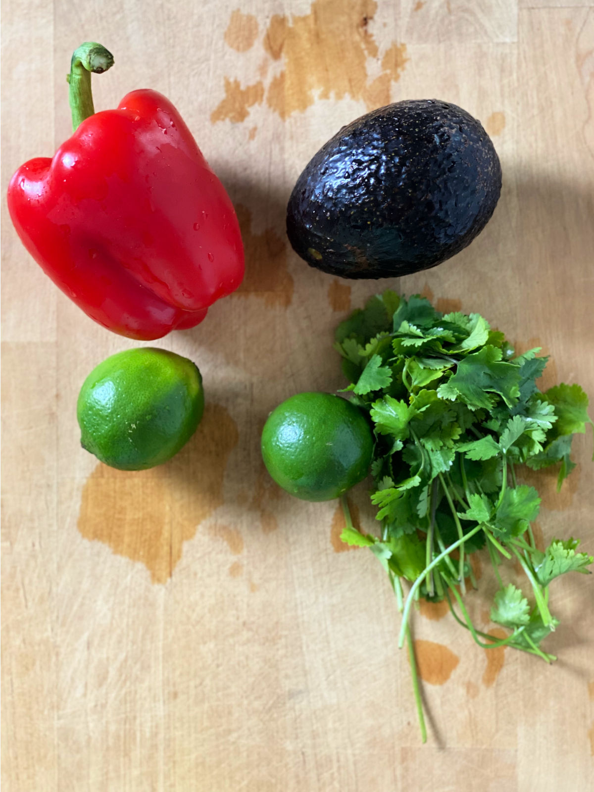 red bell pepper, avocado, limes, and cilantro