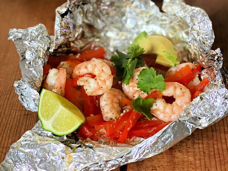 shrimp packet with red bell peppers, cilantro, avocado and lime