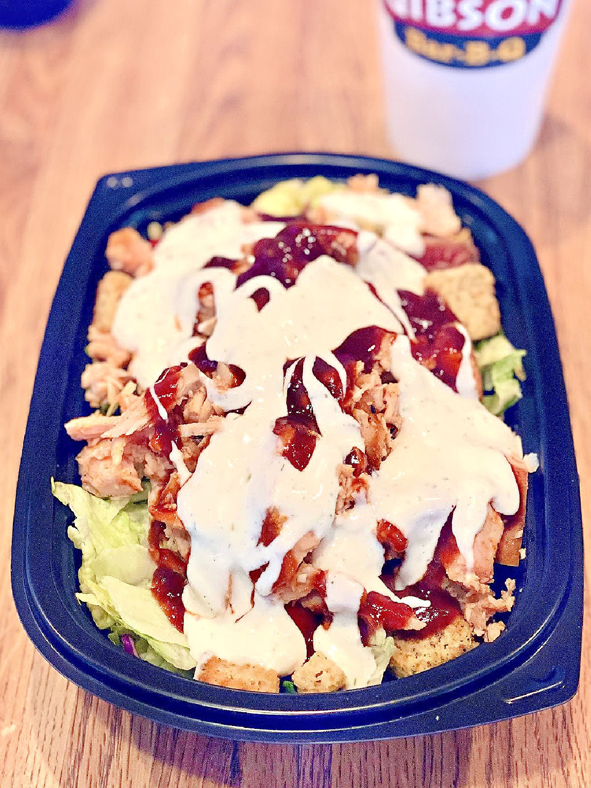 BBQ chicken salad with Alabama White sauce on top.