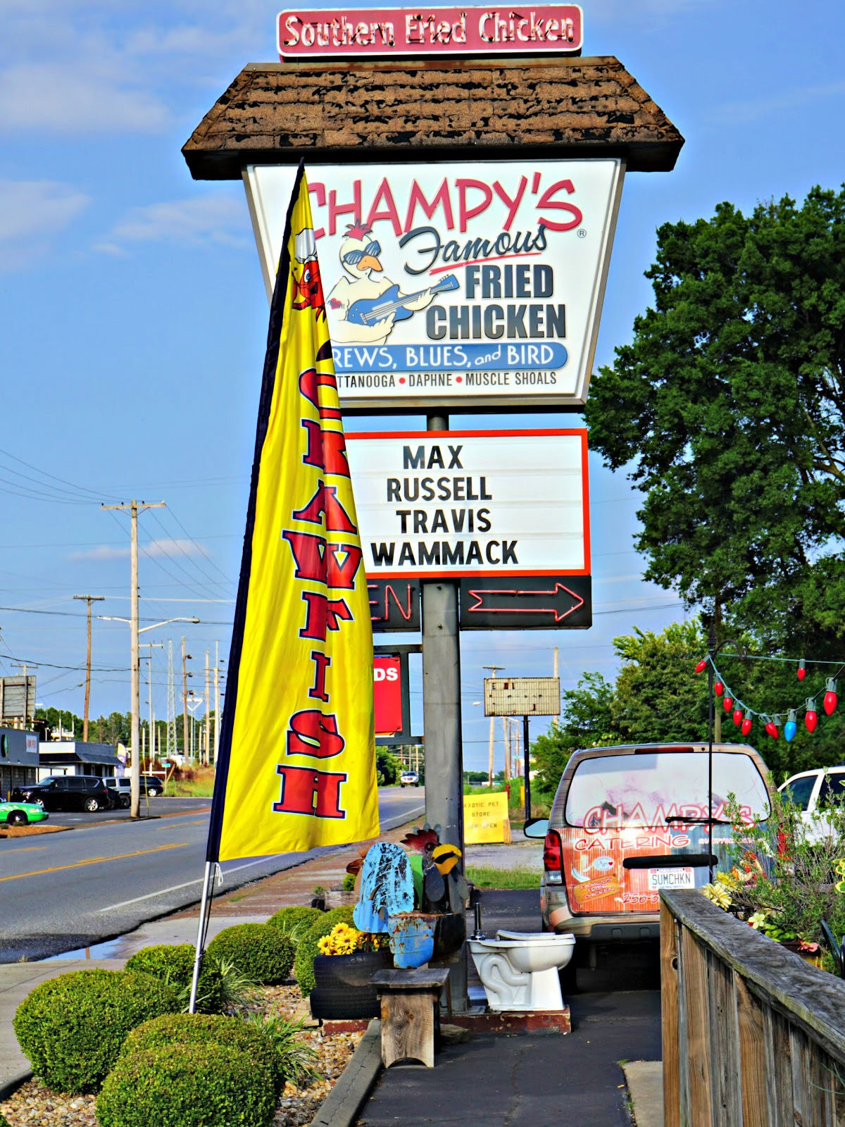 Champy's Famous Fried Chicken, Brews, Blues, and Bird sign.