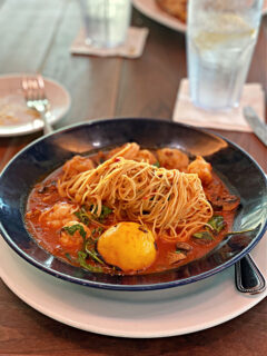 Bowl of Shrimp Fra Diavolo with a lemon wedge.