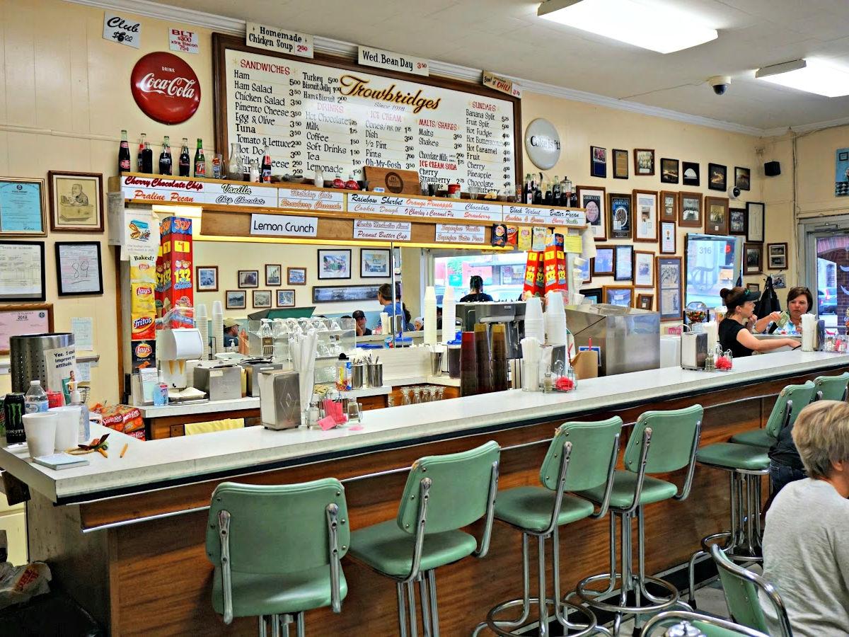The bar inside Trowbridge's restaurant with menu board.