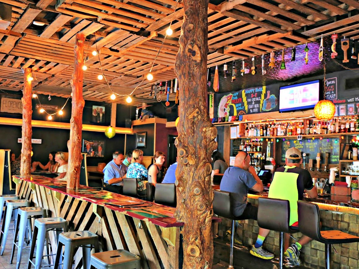 People sitting at the bar at Wildwood Tavern.