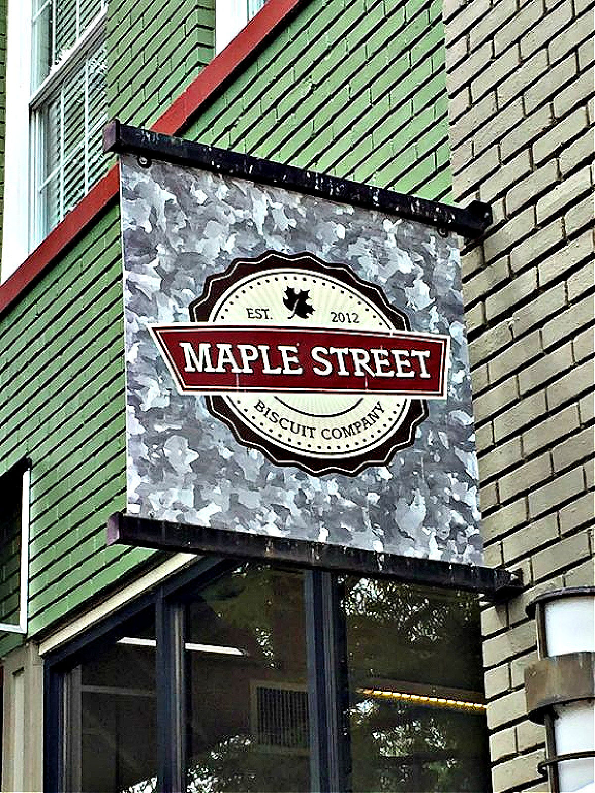 Maple Street Biscuit Company sign on building.