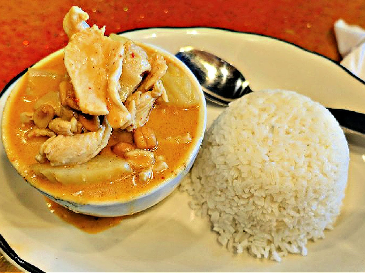 Bowl of Massaman Curry with a side of white rice.