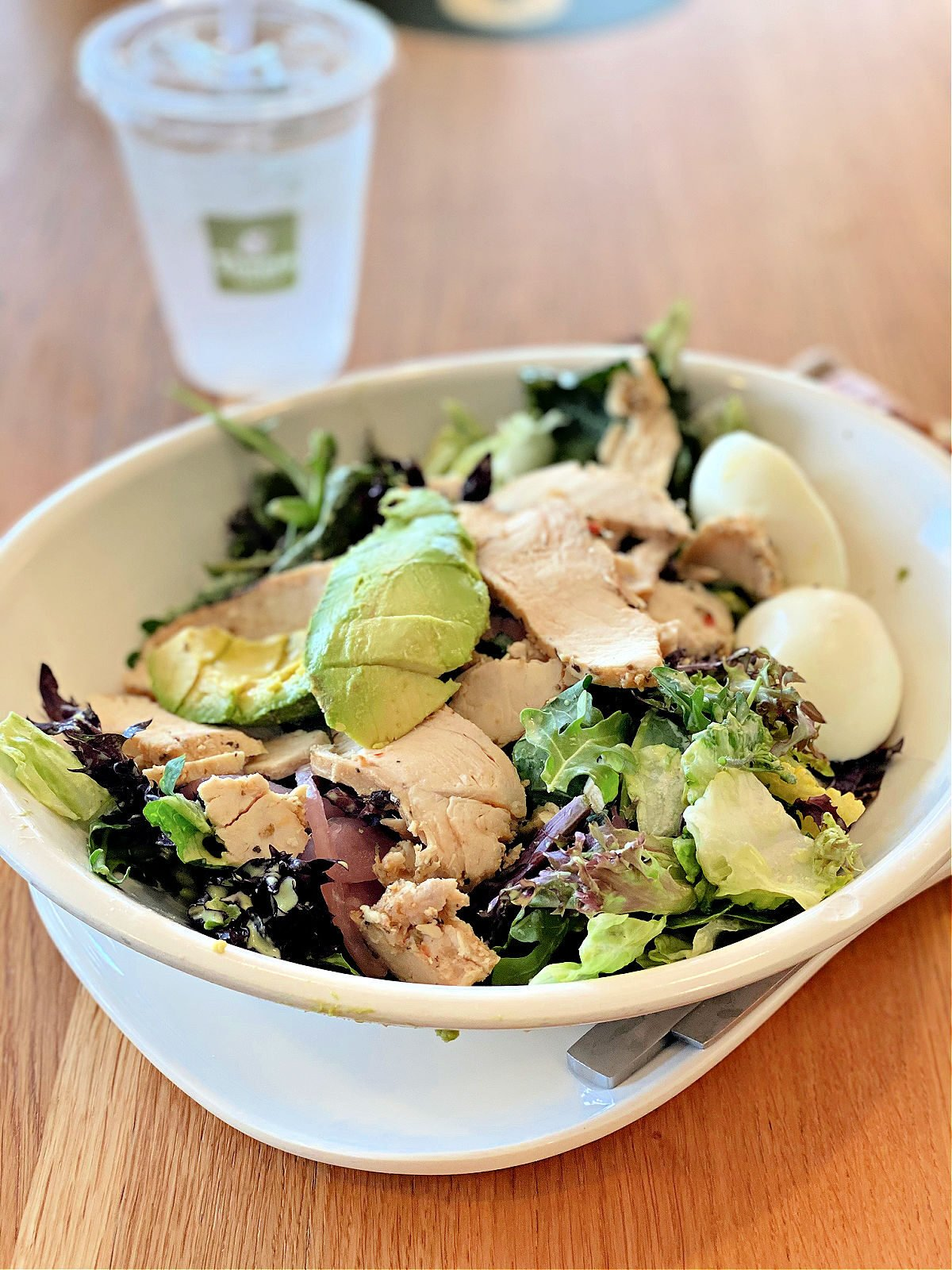 Panera's Green Goddess Salad and a cup of water.
