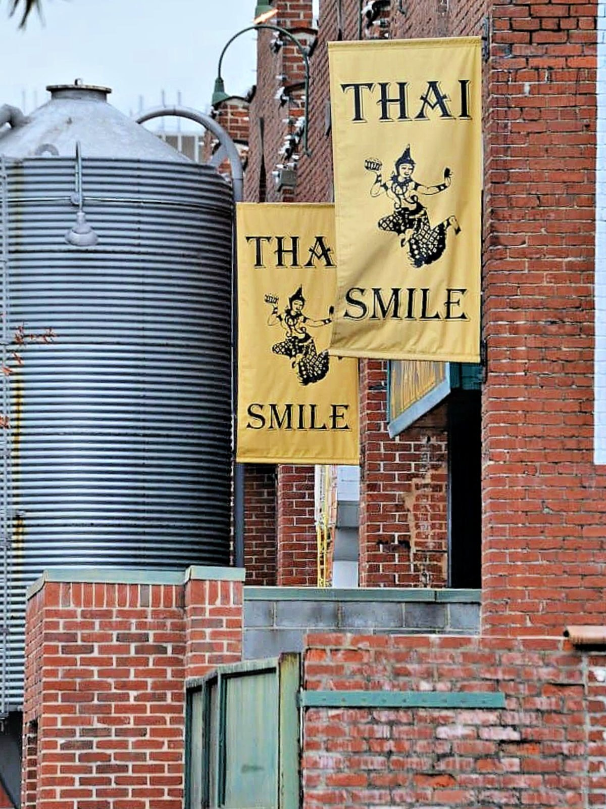 Thai Smile restaurant banners on side of building.