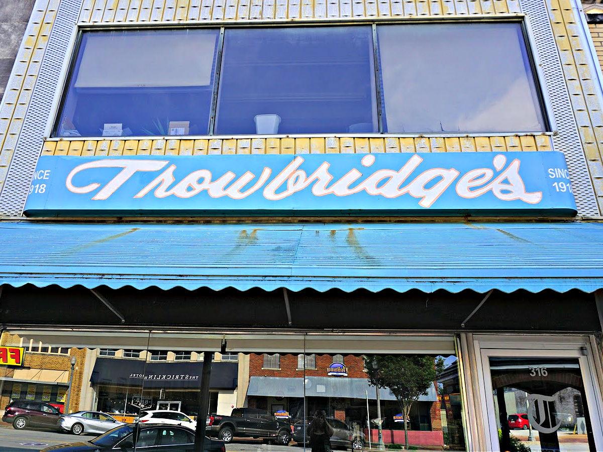 Trowbridge's blue awning and restaurant entrance.