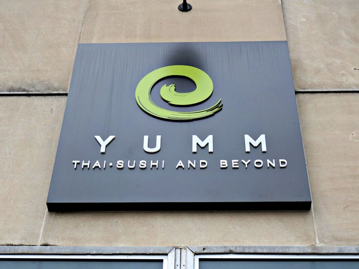 Yumm Thai Sushi and Beyond Restaurant sign.