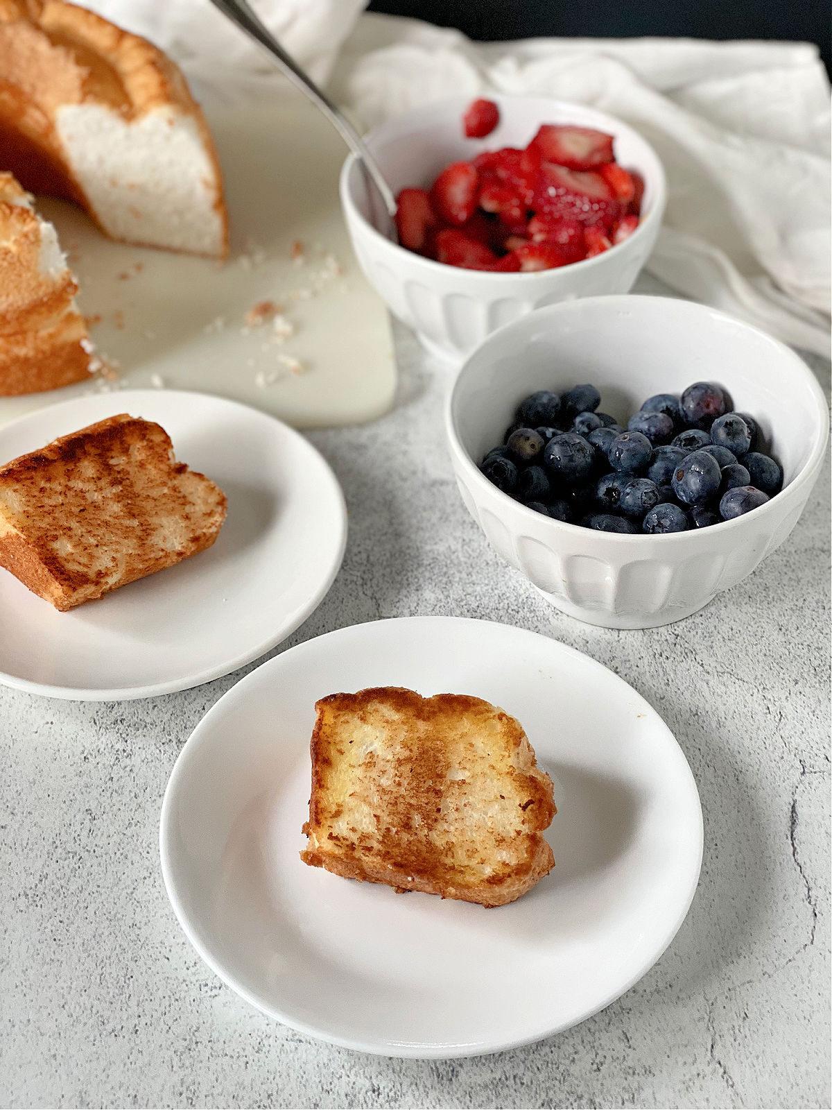 Plain toasted angel food cake on a white plate.