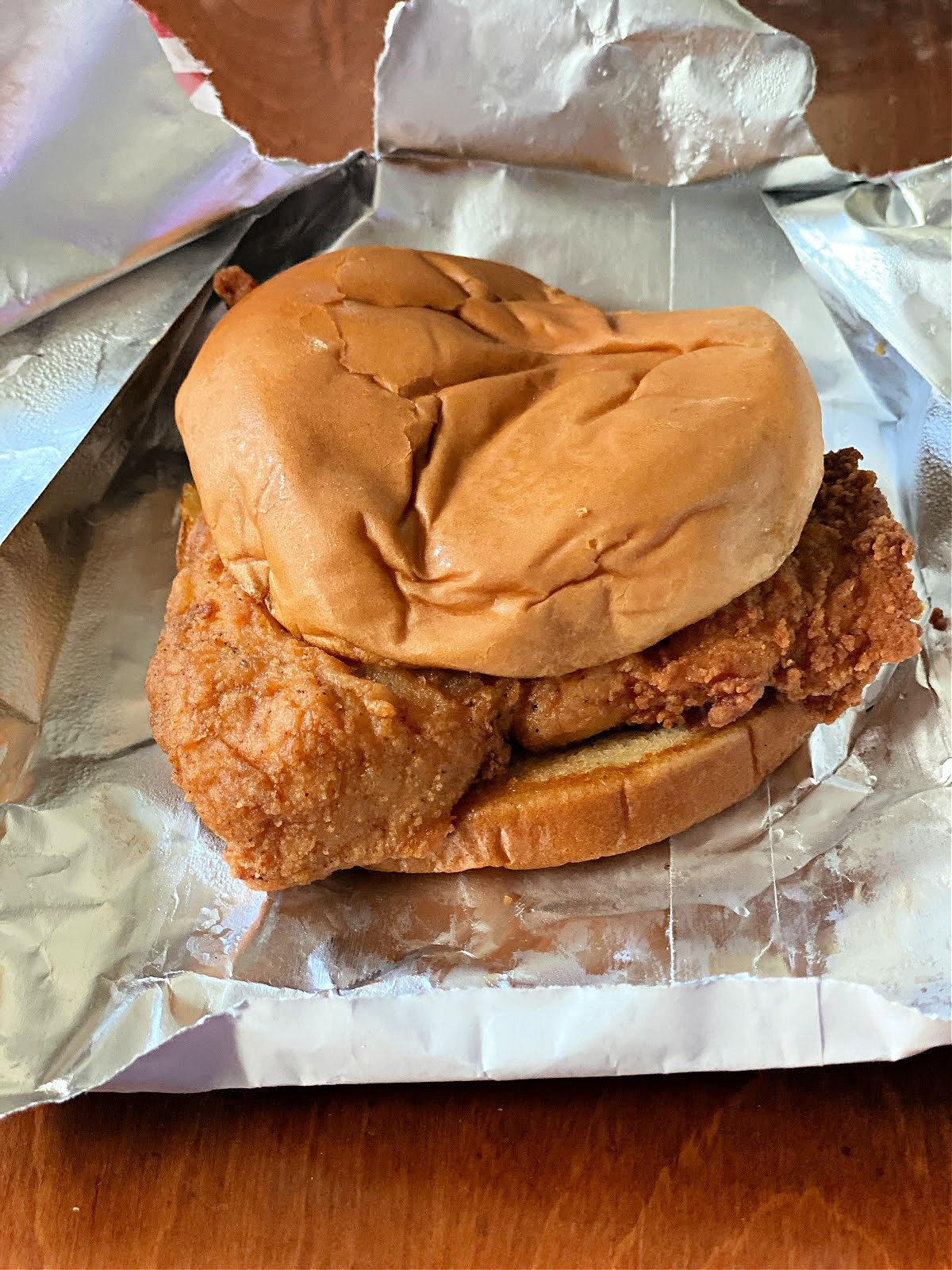 Classic Chick-Fil-A sandwich sitting on its wrapper.