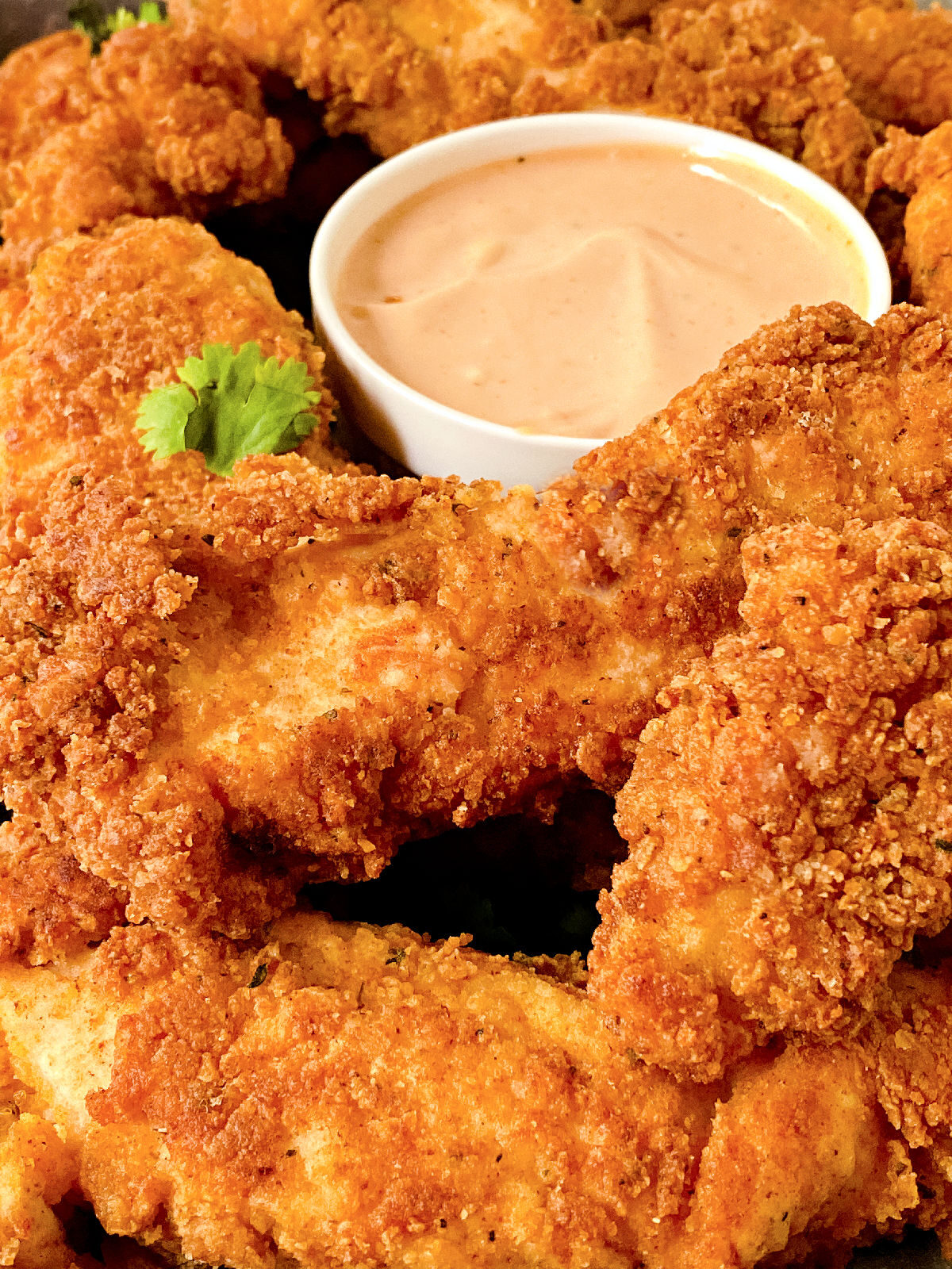 Platter of chicken tenders and dipping sauce.