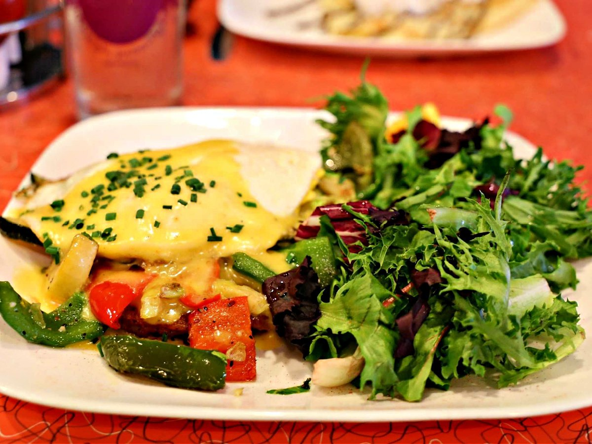 Roasted zucchini, squash, asparagus, onions, peppers, Brussels sprouts, 2 eggs over easy and hollandaise.