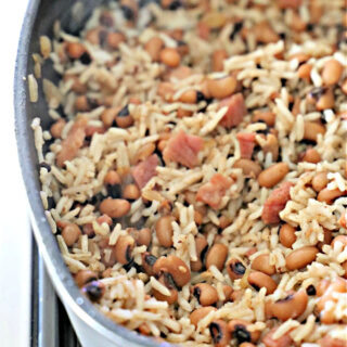 Gray non-stick skillet with rice and black-eyed peas.