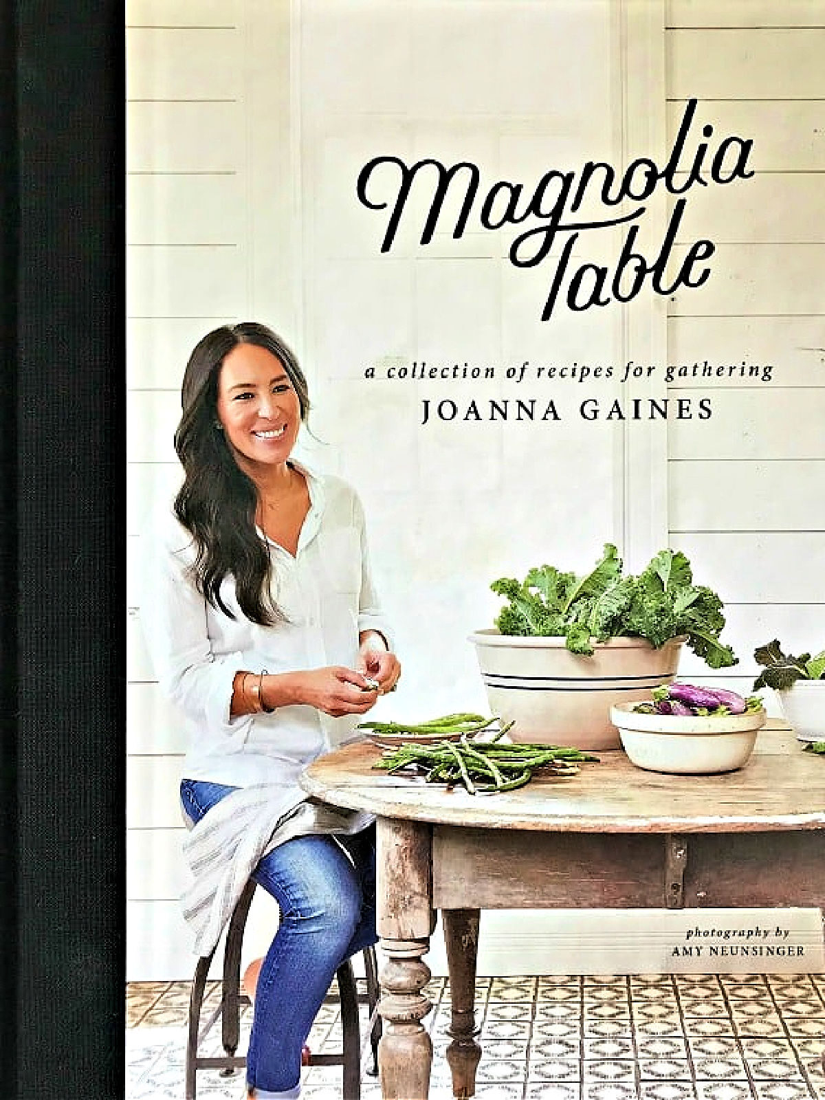 Magnolia Table cookbook with picture of woman shelling peas.