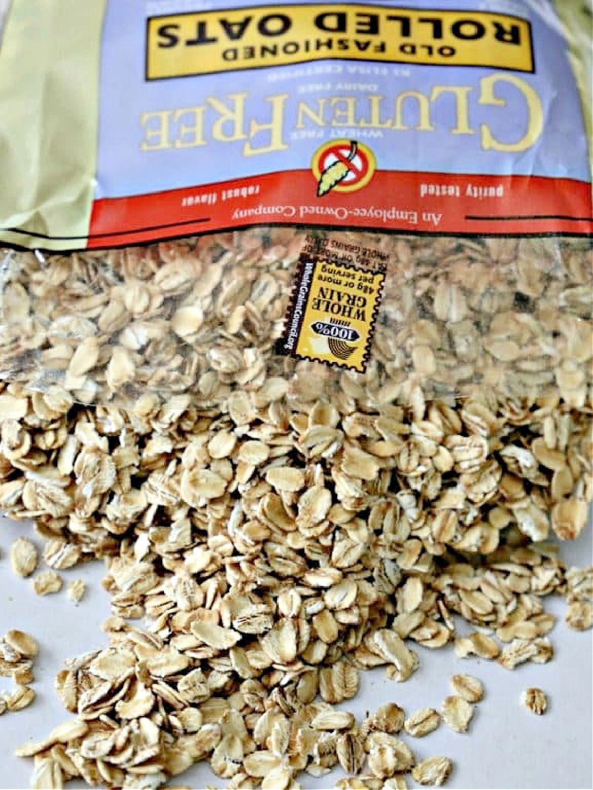 Bag of old fashioned oats spilling out onto a table.