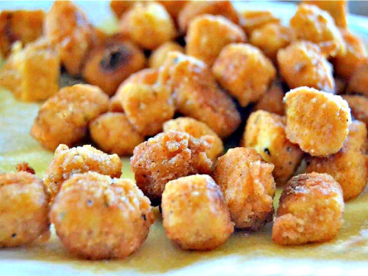 Popcorn tofu nuggets on a paper towel.
