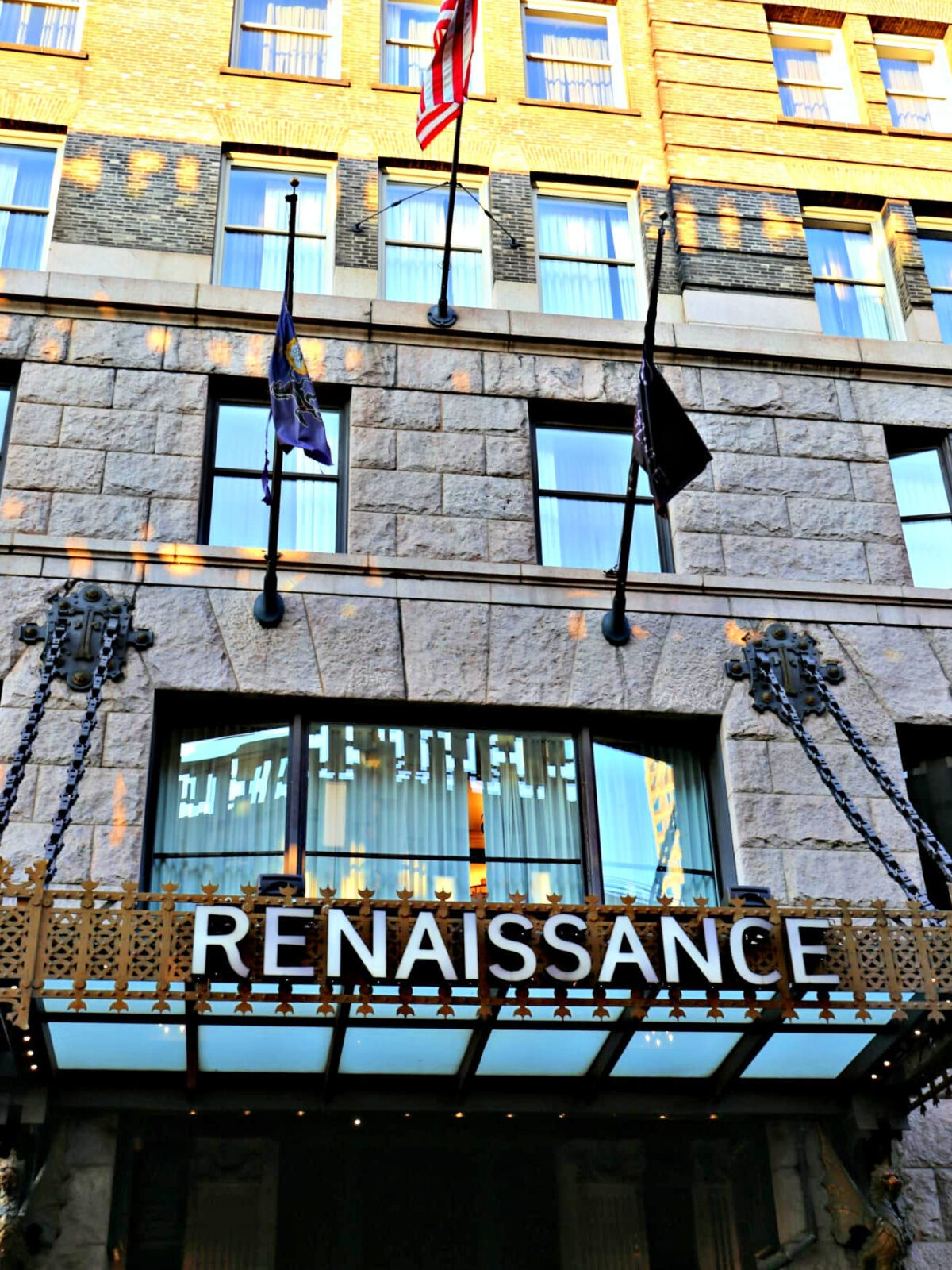 The front of Renaissance Pittsburgh with flags flying.