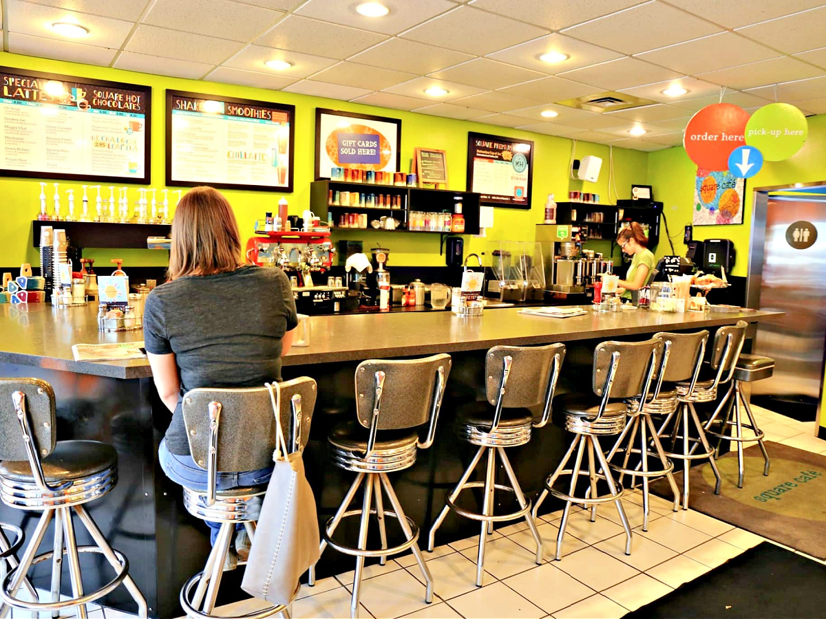 Woman sitting at counter at Square Cafe.