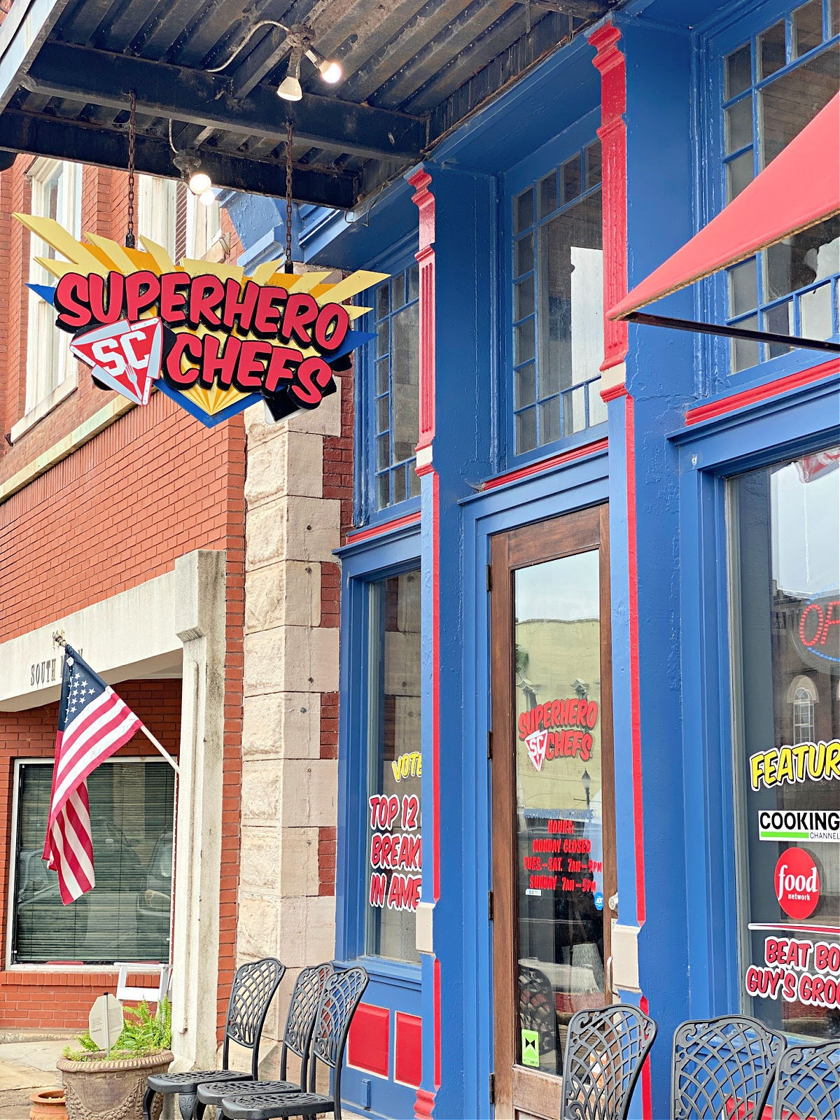 Superhero Chefs restaurant painted red and blue building.