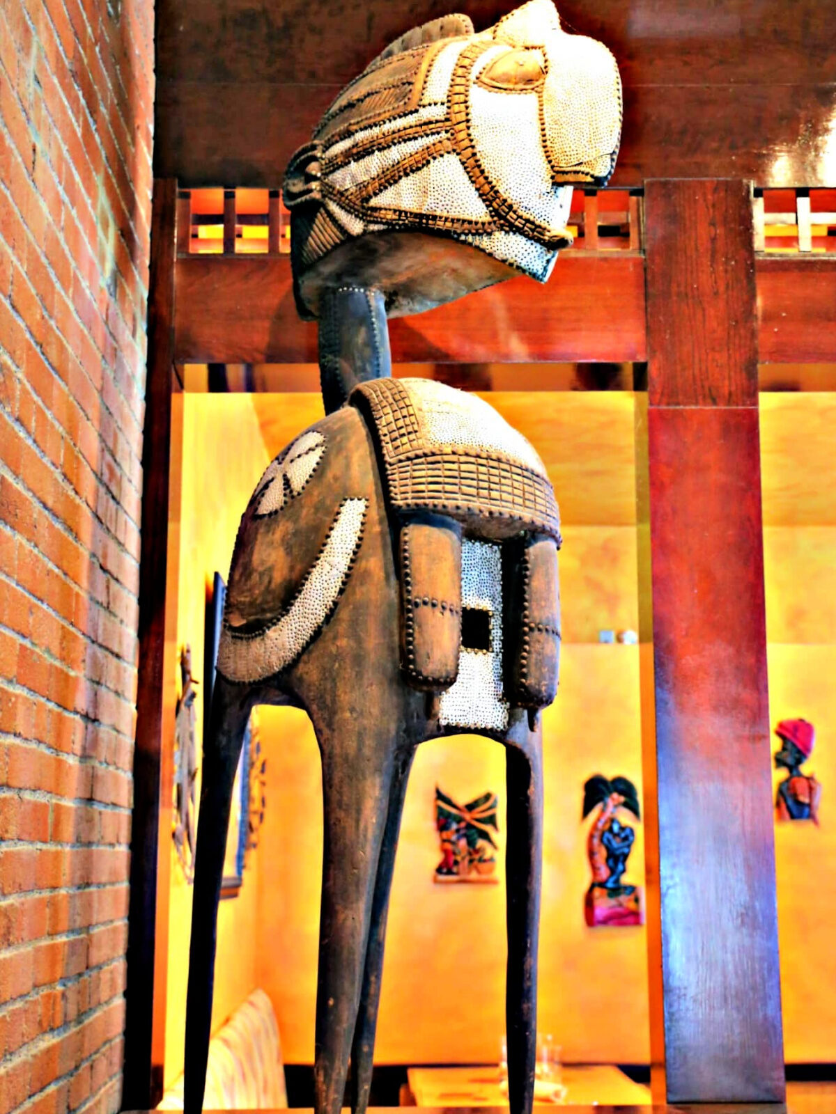 Latin sculpture with four legs inside a restaurant.