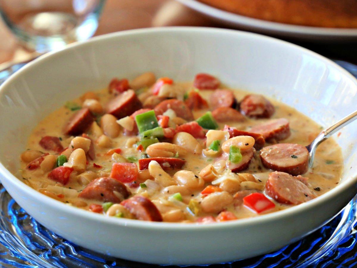 Bowl of cajun chili and sausage.