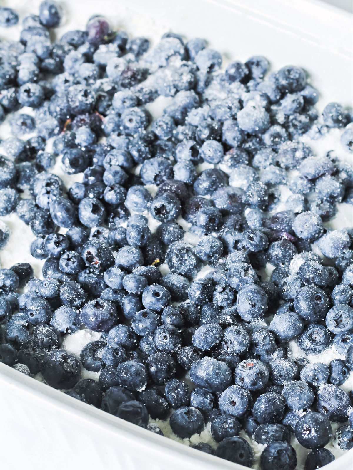Blueberries topped with sugar in a baking dish.
