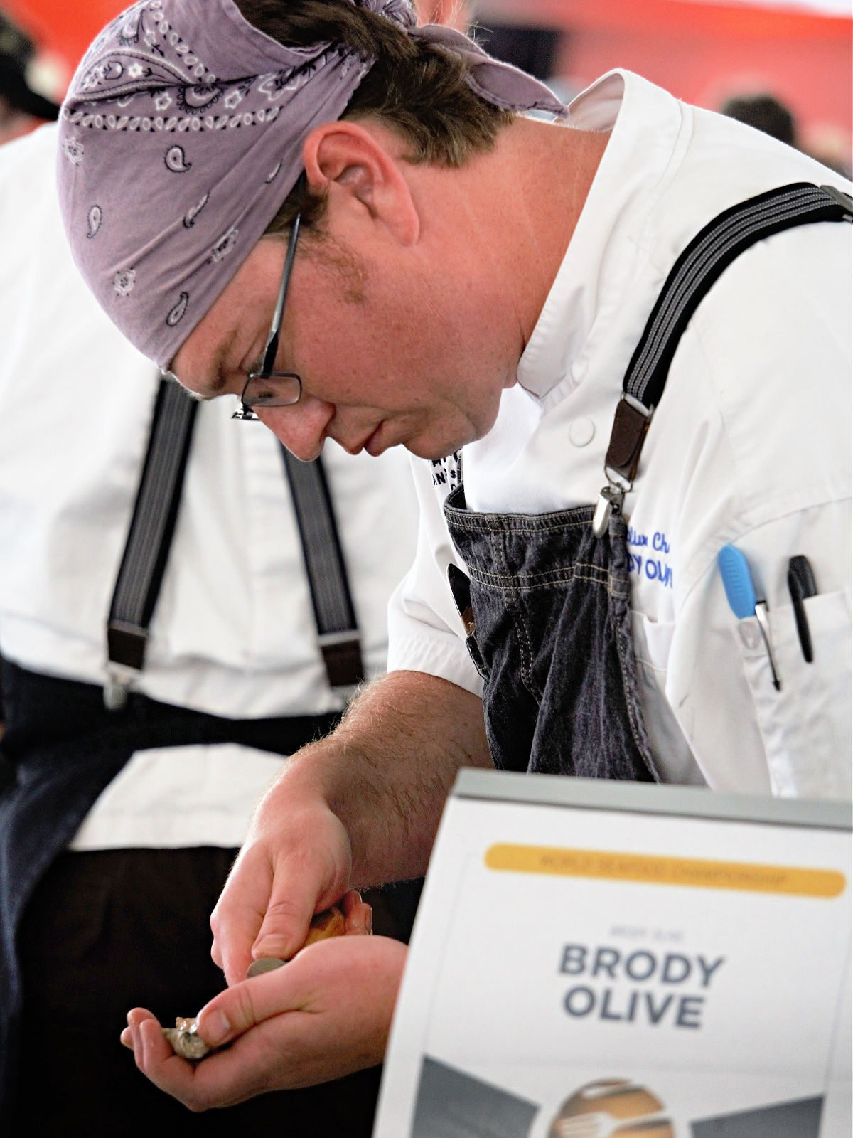 Chef Brody Olive shucking oysters at the World Food Championships.