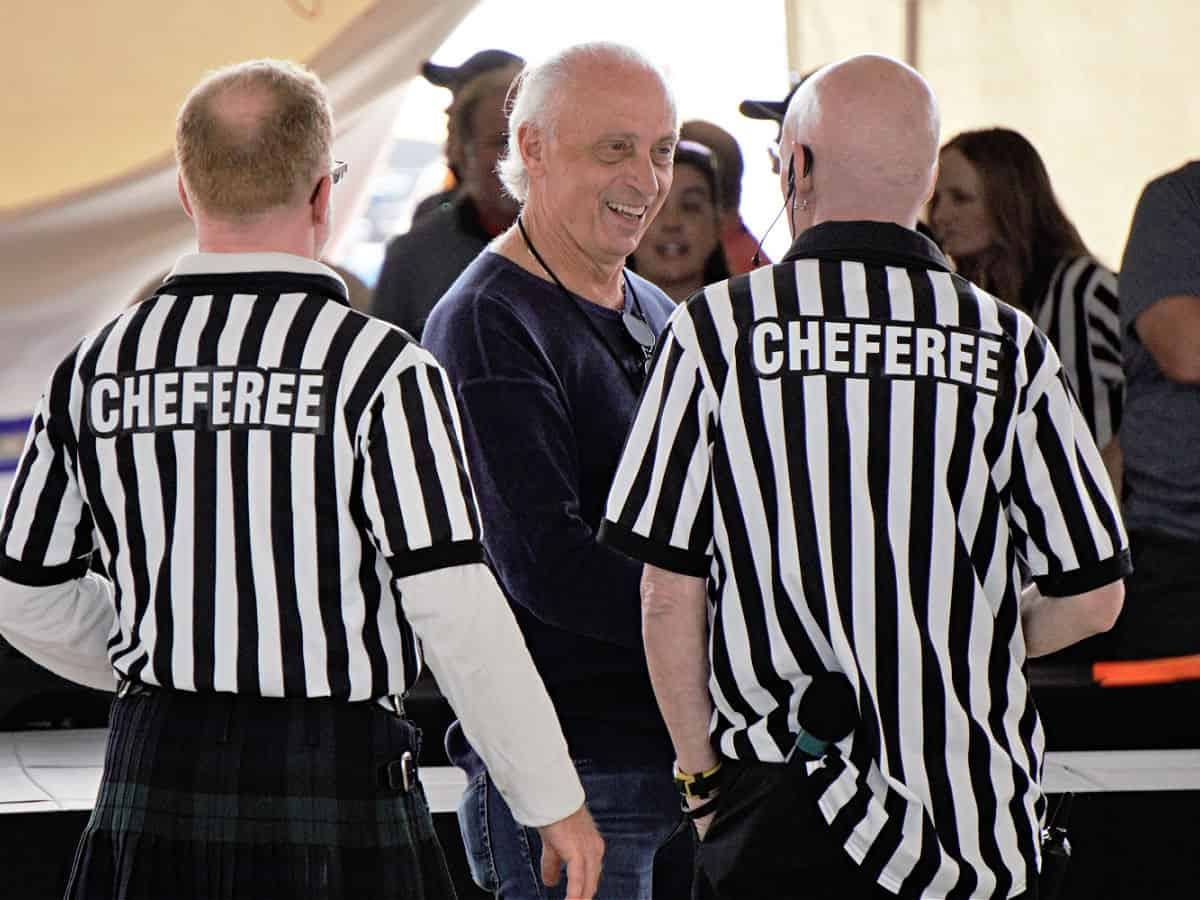 Men wearing referee shirts.