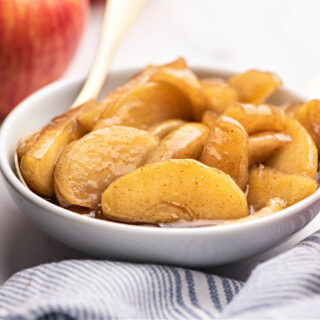 White bowl filled with fried apples.