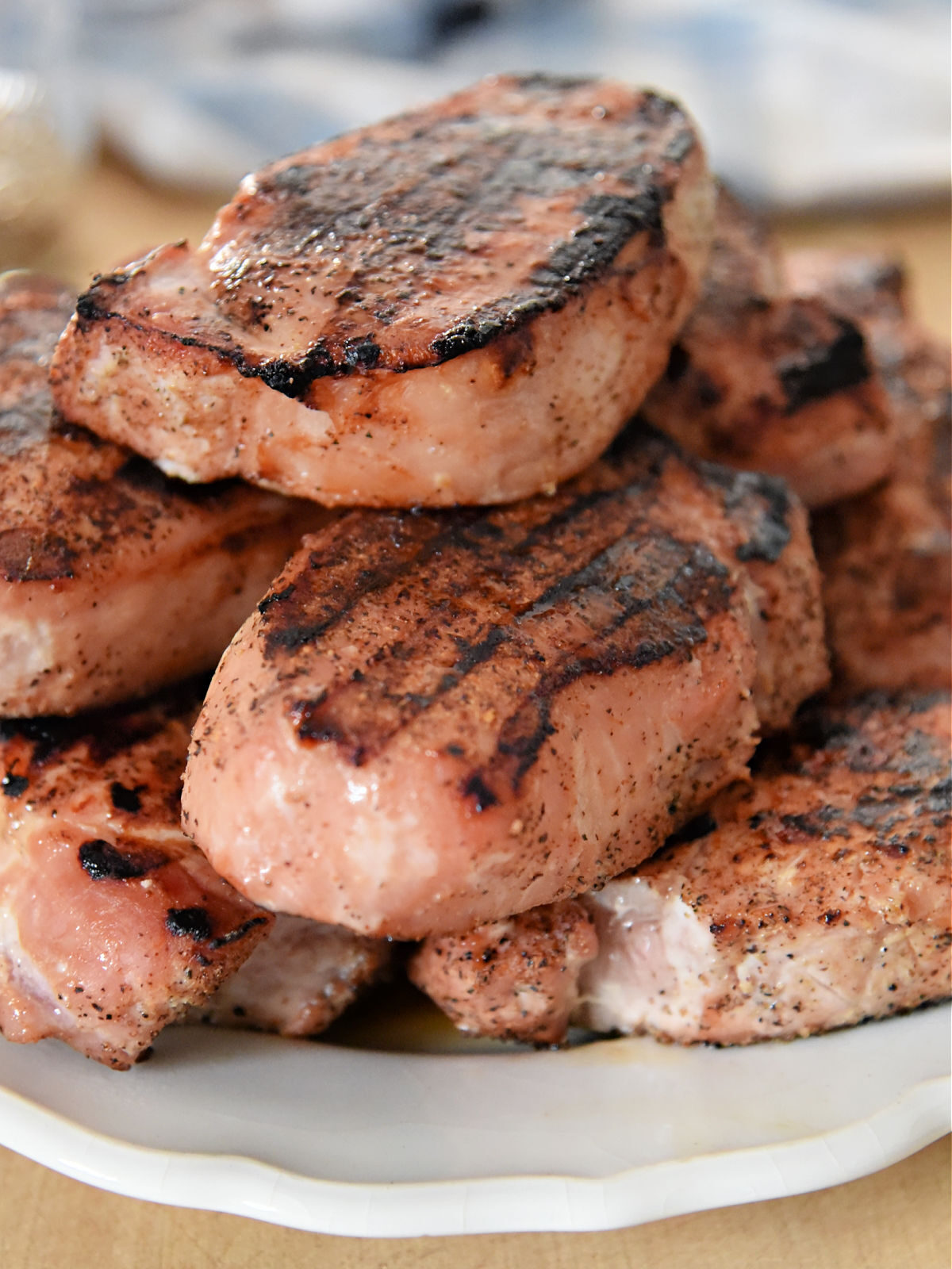Platter topped with grilled pork chops.