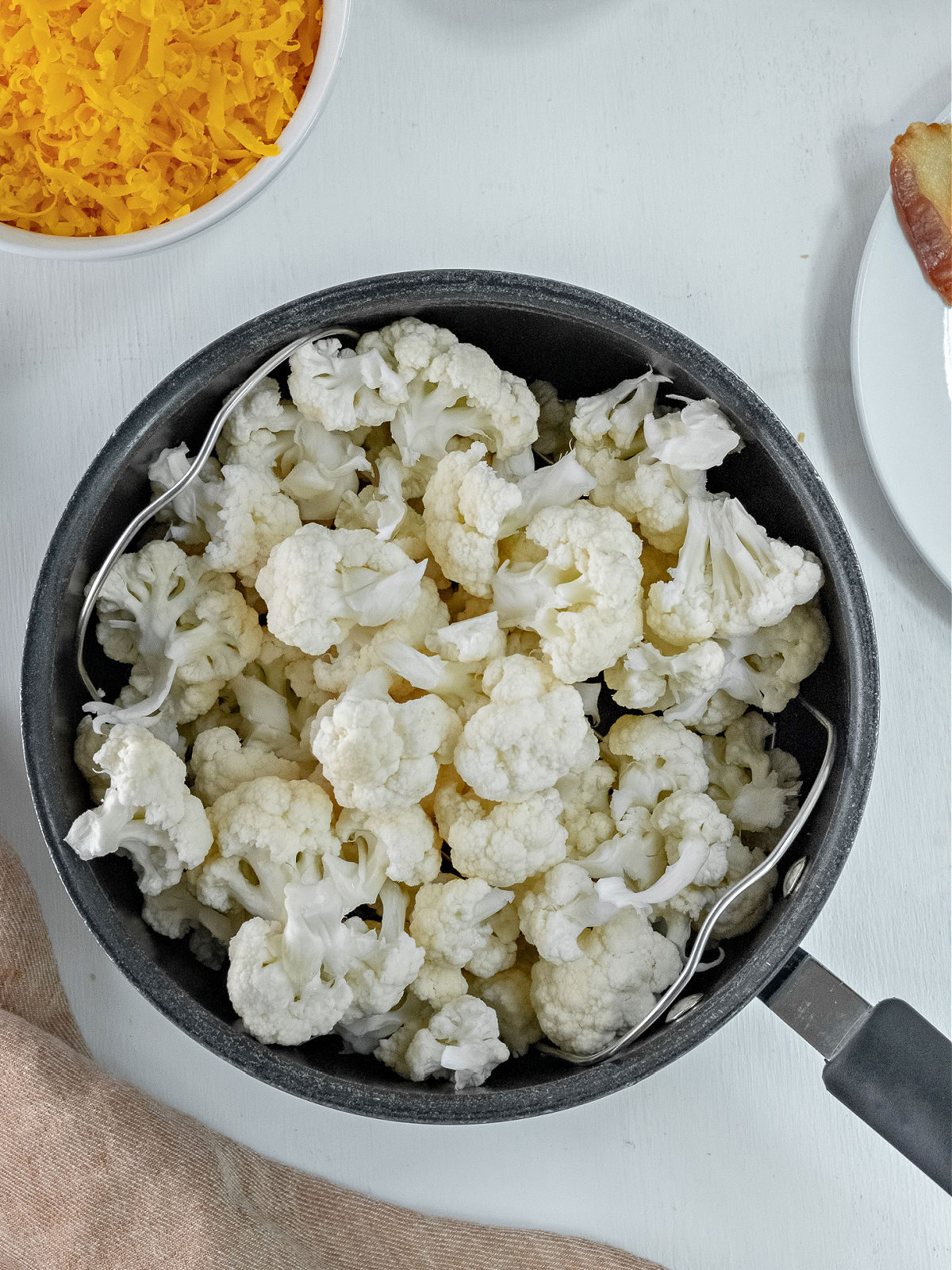 Pot filled with cauliflower florets.
