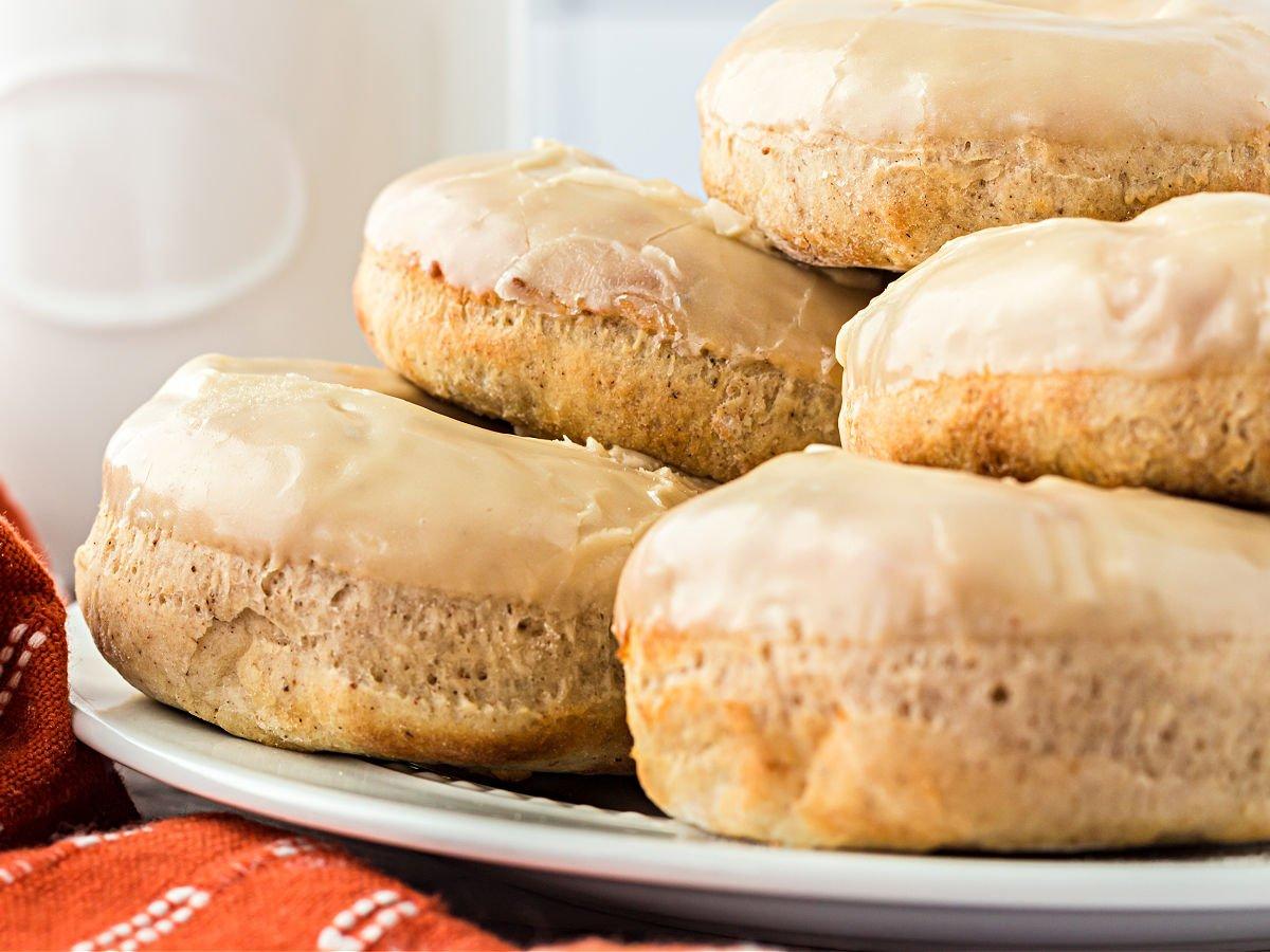 Plate of glazed maple doughnuts.