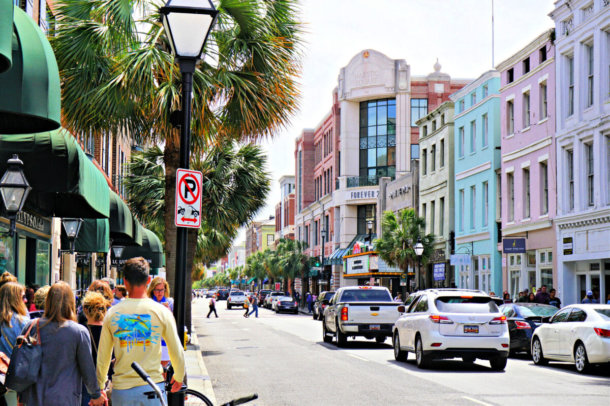 Street in Charleston with colorfully painted buildings.