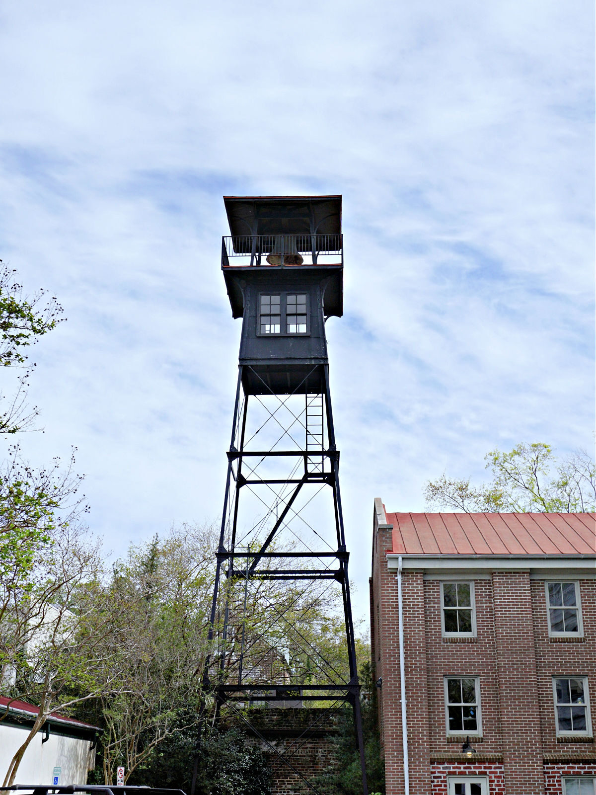 Fire tower next to a building.